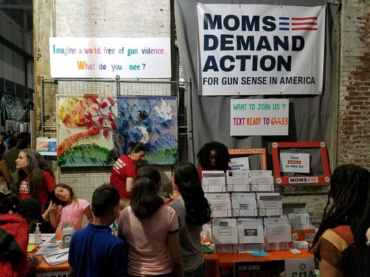 The Moms Demand Action for Gun Sense table at Art All Night in Trenton asked participants to imagine a world without gun violence and write their thoughts on small piece of paper to be included in an interactive mural. At 2:45 a.m. at least three gunmen disrupted the annual event and sent 20 victims to the hospital.