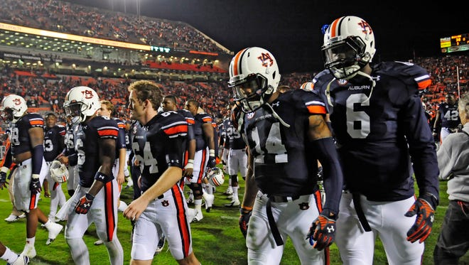 Nick Marshall (14) and Jeremy Johnson (6) walk off the field after Auburn's upset loss to Texas A&M.