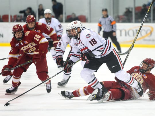 St. Cloud State's Judd Peterson breaks away with the puck during the first period of the Saturday, Feb. 24, game against Denver at the Herb Brooks National Hockey Center in St. Cloud.