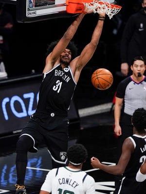Brooklyn Nets' Jarrett Allen (31) dunks the ball in front of Utah Jazz's Mike Conley (10) during the second half of an NBA basketball game Tuesday, Jan. 5, 2021, in New York. (AP Photo/Frank Franklin II)