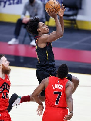 Cleveland Cavaliers' Collin Sexton (2) goes up for a shot against Toronto Raptors' Kyle Lowry (7) in the first half of an NBA basketball game, Sunday, March 21, 2021, in Cleveland. (AP Photo/Ron Schwane)