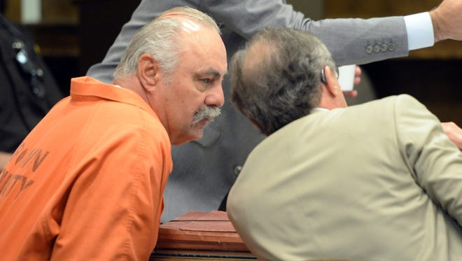 Keith Kutska, left, confers with a defense attorney during a hearing in July in Brown County Circuit Court.