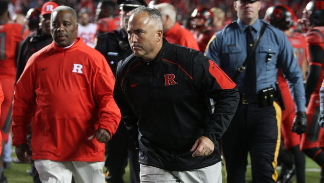 Rutgers coach Kyle Flood jogs from the field after falling to Ohio State 49-7, Saturday, October 24, 2015, in Piscataway.