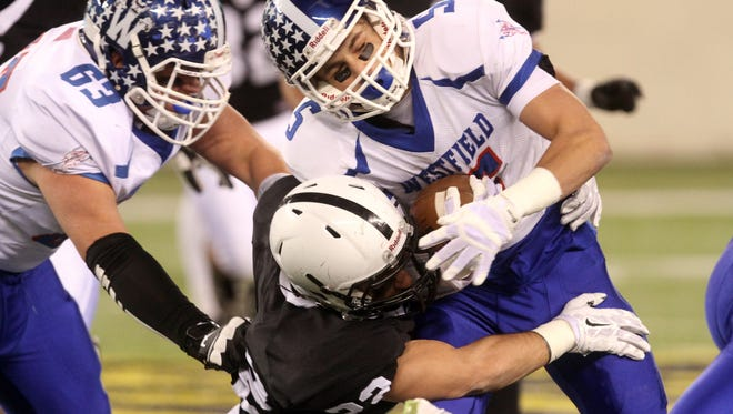 Westfield's Jack Shirk collides with Bridgewater-Raritan defender Anthony Vizzoni in the North 2 Group V championship game, Thursday, December 3, 2015, at MetLife Stadium in East Rutherford.