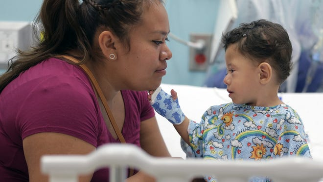 Sanjuana Escobar spends quality time with her son, Santos Escobar, before he's wheeled into surgery.