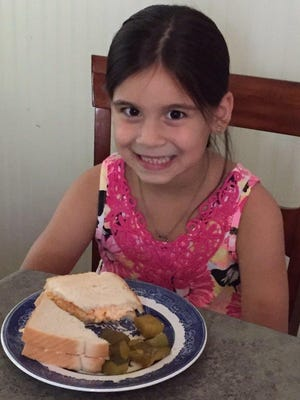 """""""Sweet pickles taste awesome with my pimento cheese sandwich,"""" says Ava Torres-Acahua, second-grade student at Arlington Elementary School."""