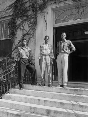 This Sept. 1955 photo provided by the Roland Giduz Photographic Collection/The Wilson Library at UNC Chapel Hill, shows from left, LeRoy Frasier, John Lewis Brandon and Ralph Frasier on the steps of the University of North Carolina at Chapel Hill, N.C. LeRoy Frasier, who along with his brother and another high school student was among the first African-American undergraduate students to successfully challenge racial segregation at North Carolina's flagship public university, has died at the age of 80. Fraser died of heart failure on Dec. 29, 2017, in New York City.