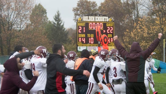 Valhalla coaches and players celebrate as the scoreboard