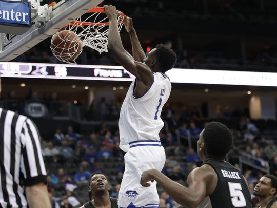 Seton Hall's Michael Nzei (1) dunks against Providence.