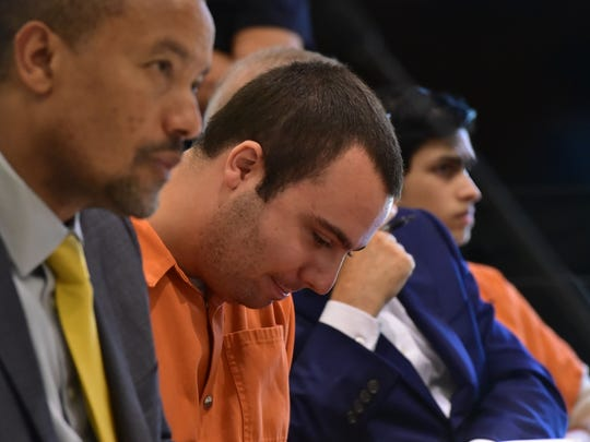 Anthony Graziano puts his head down after learning of his 35 years sentence on Friday, July 28, 2017.