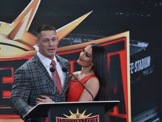 John Cena and his spouse Nikki Bella speak at a press conference in East Rutherford, NJ.