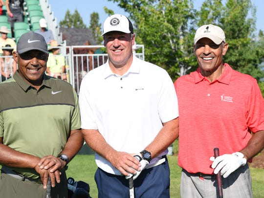 Marvin Lewis (left), Doug Pederson (center) and Herm