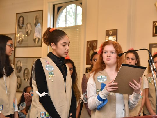 Michaela Glavin and Eliza Silletto of Teaneck Girl Scout Troop 19 speak about a 5-cent fee before the Township Council in 2017.