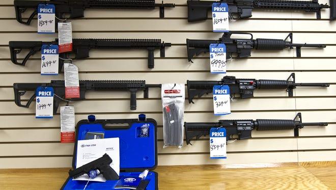 An assortment of AR-15 rifles on display at a Florida gun shop.