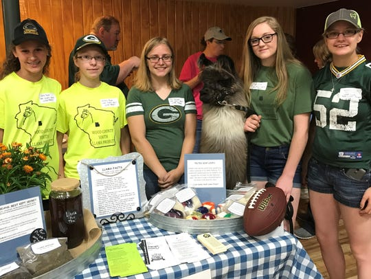 Wood County Youth Llama Project members (from left) Emily Bruhn, Brittany Bauer, Heidi Kudinger, Morgan Sachs, Michelle Kundinger are joined by Lulu the llama at Farm Technology Days Media Day in June. Members will be on hand in the Land O Lakes Future Generations tent to introduce their llamas to guests and answer questions.