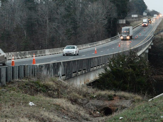 Cars and trucks pass over the Southbound bridge over Three and Twenty Creek of Lake Hartwell on I-85 in at the 14 mile Anderson County on Tuesday.