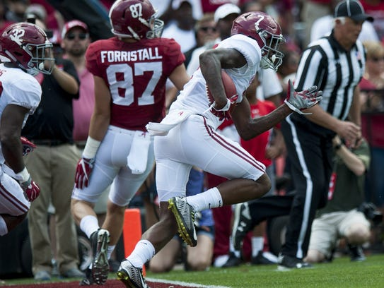 Alabama's Trevon Diggs (7) returns an interception
