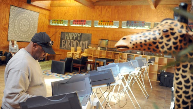 Hattiesburg resident Melvin Thompson votes in in the May 2 primary at Kamper Park.