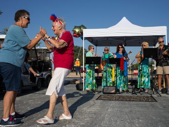 Sun City residents Shirley Barone (right) and Donna Barbaria dance before a parade, Aug. 14, 2014, celebrating the ceremonial signing of HB 2027, at the Fairway Recreation Center in Sun City.