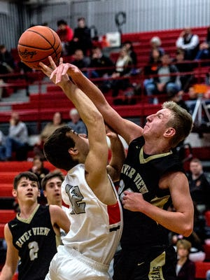 Chase Whitehair of River View blocks Nick Morton of Ridgewood from shooting the ball during Ridgewood's win on Wednesday. River View beat Newcomerstown and Ridgewood lost to Coshocton on Thursday.