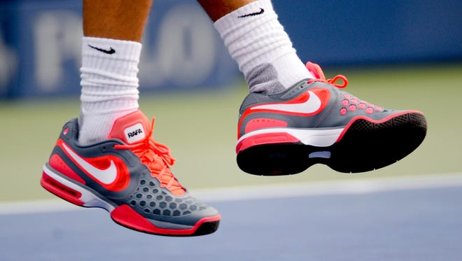 A view of the shoes of Rafael Nadal as he serves to Ryan Harrison.