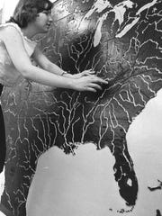 Caroline Truit explored a map with raised featured to help her understand geography. 1965