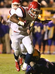 Oakland's Lazarius Patterson (4) runs the ball as Smyrna's Devin Smith (25) tackles Patterson during the game at Smyrna, on Friday Oct. 30, 2015.
