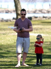 John and Makenzie Simonich, of Fond du Lac, fly a  drone in Lakeside Park Saturday. Father and daughter were out enjoying the warm weather.