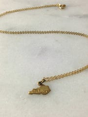 Find this brass Kentucky necklace ($15), made by local