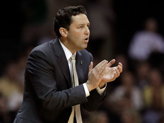 Vanderbilt head coach Bryce Drew cheers on his team against UNC-Asheville during the first half of an NCAA college basketball game in Nashville, Friday, Nov. 17, 2017. (AP Photo/Mark Humphrey)