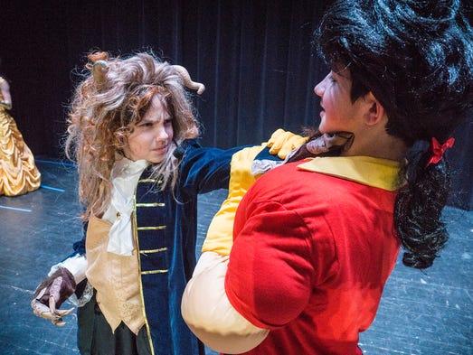 The Beast (Jayce Elmore) attacks Gaston (Shawn Kinsey).