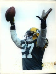 Terrell Buckley holds the football aloft after picking off his second pass of the afternoon against the Rams in 1992.