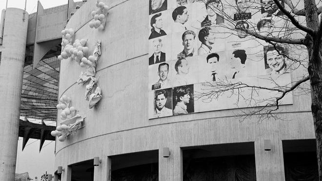 This April 1964 photo shows a 20-by-20-foot mural by Andy Warhol.  AP