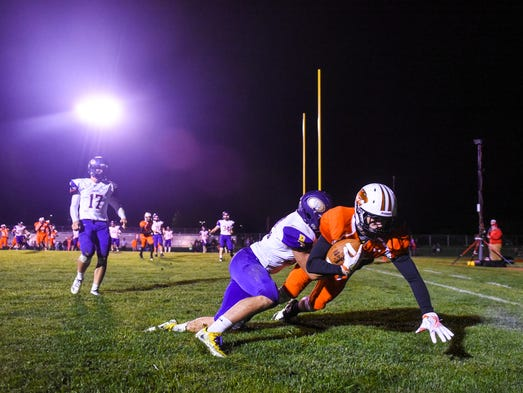 Palmyra's Braden Vernet falls in the end zone after