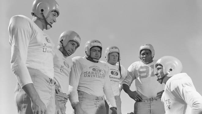Vito (Bae) Parilli, lower right,  (left to right) Bobby Dillon, Bill Reichardt, Chuck Boerio, Bill Howton, Tom Johnson on July 31, 1952.