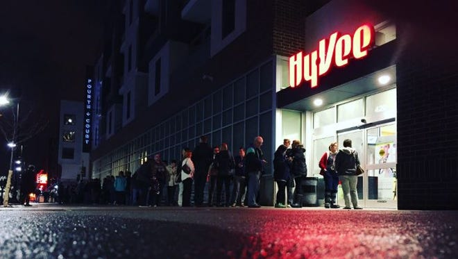 The first shoppers at the downtown Hy-Vee line up early Tuesday morning, Feb. 28, waiting for the store to open its doors.