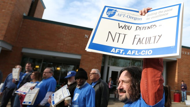 Scott Beaver, a math projessor, attends a rally in support of a contract with pay equity for non-tenure-track faculty members on Wednesday, Jan. 27, 2016, at Western Oregon University in Monmouth, Ore.