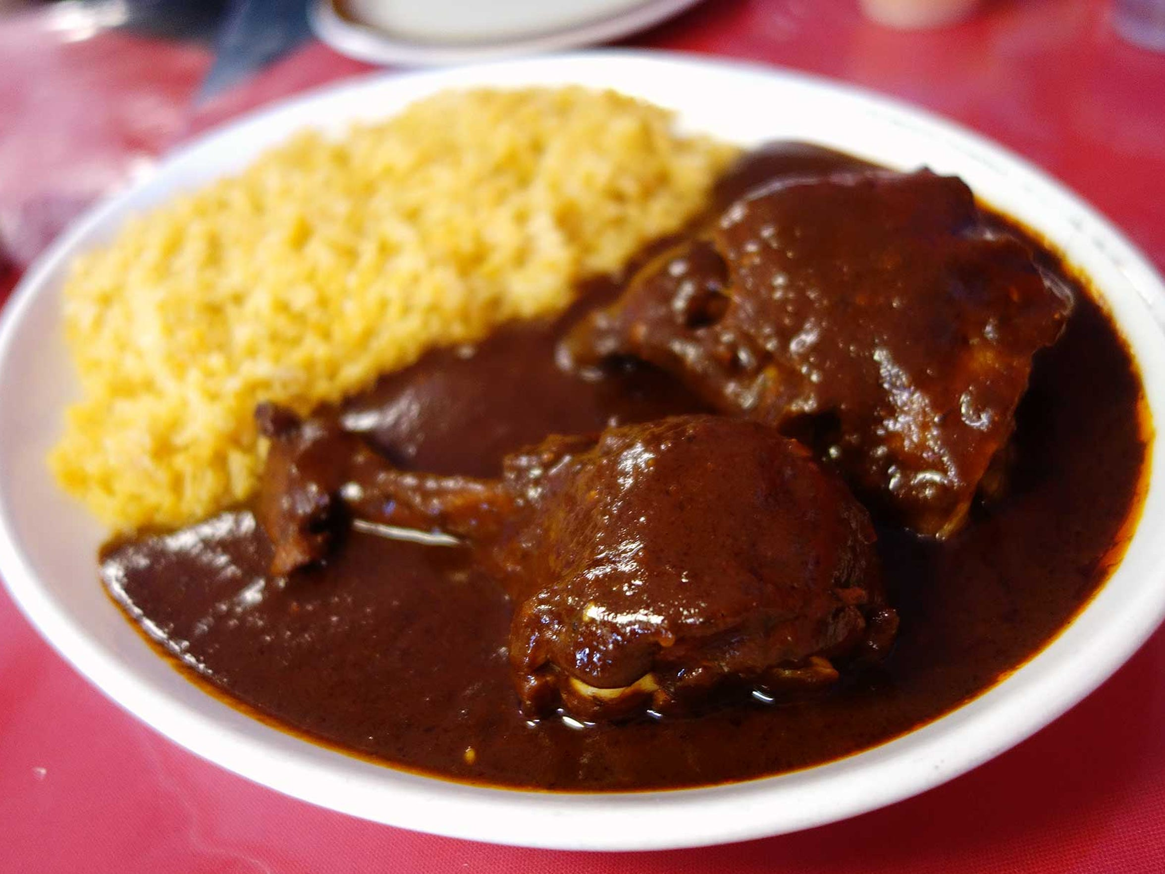 Chicken with mole poblano and rice at Restaurant Huauchinangos.