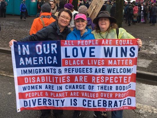 Molly Lee, left, at the women's march in Portland.