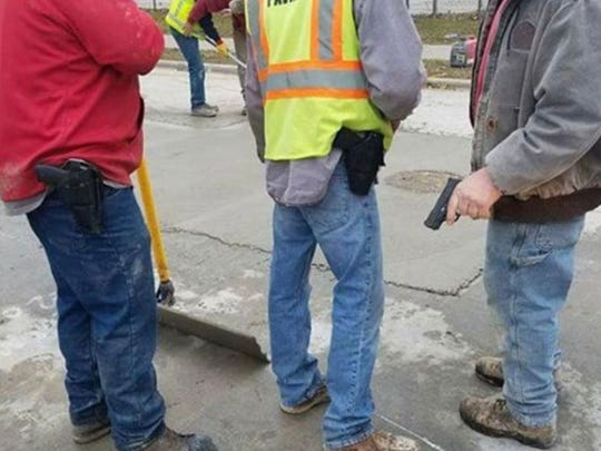 A photo shared on Facebook appears to show three subcontractor employees at a City of Milwaukee work site openly brandishing guns.