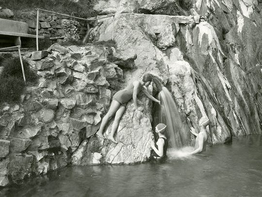 Bathers enjoy one of the upper pools fed by the namesake