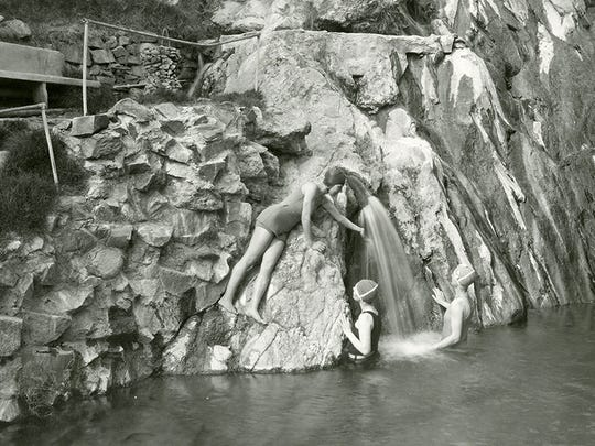 Bathers enjoy one of the upper pools fed by the namesake waters of Castle Hot Springs.