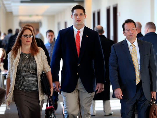 Former Vanderbilt University football player Brandon Vandenburg, center, arrives for jury selection in his trial Monday, Nov. 3, 2014, in Nashville, Tenn. Vandenburg and former teammate Cory Batey are charged with the rape of an unconscious 21-year-old female student on June 23, 2013.