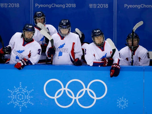 FILE - In this Feb. 18, 2018 file photo, North Korea's Jin Ok (32), of the combined Koreas team, joins teammates Park Yoonjung (23), Park Ye-eun (11), Kim Selin (8), and Kim Heewon (12) during the third period of the classification round of the women's hockey game at the 2018 Winter Olympics in Gangneung, South Korea. The Korean women's hockey team coming together for the Pyeongchang Games helping countries separated for decades to come together -  if only for a few weeks of games - is a moment for history. Now only South Korea can decide if hockey fever takes root and the country becomes a regular on the international stage, or if all this effort was simply to put on a good show as Olympic hosts. (AP Photo/Frank Franklin II, File)