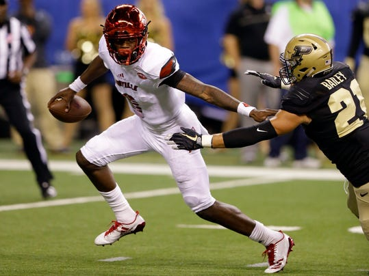FILE - In this Sept. 2, 2017, file photo, Louisville quarterback Lamar Jackson (8) gets away from Purdue linebacker Markus Bailey (21) during the first half of an NCAA college football game in Indianapolis. Reigning Heisman Trophy winner Jackson had 485 yards of total offense in the season opener and leads the Cardinals into their Atlantic Coast Conference opener at North Carolina on Saturday, Sept. 9, 2017. (AP Photo/Michael Conroy, File)