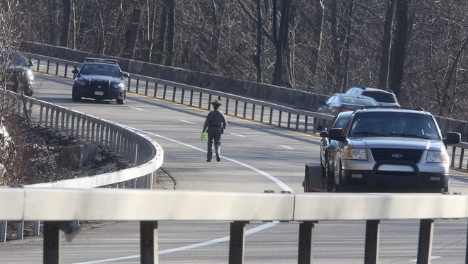 Police at the the scene of a fatal crash involving a motorcycle on the Taconic State Parkway, a half a mile north of Bryant Pond Road. At right, a car was towed away from the scene on Sunday, Feb. 28, 2016.
