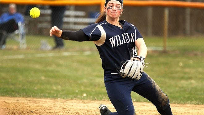 Archies shortstop Meg Marcel makes a throw to first from one knee as Archbishop Williams hosts Abington in girls softball, Friday, April 13, 2018.Gary Higgins/The Patriot Ledger