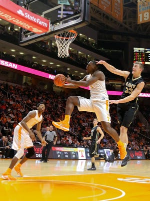 Tennessee forward Armani Moore (4) goes to the basket against Army on Nov. 24, 2015.