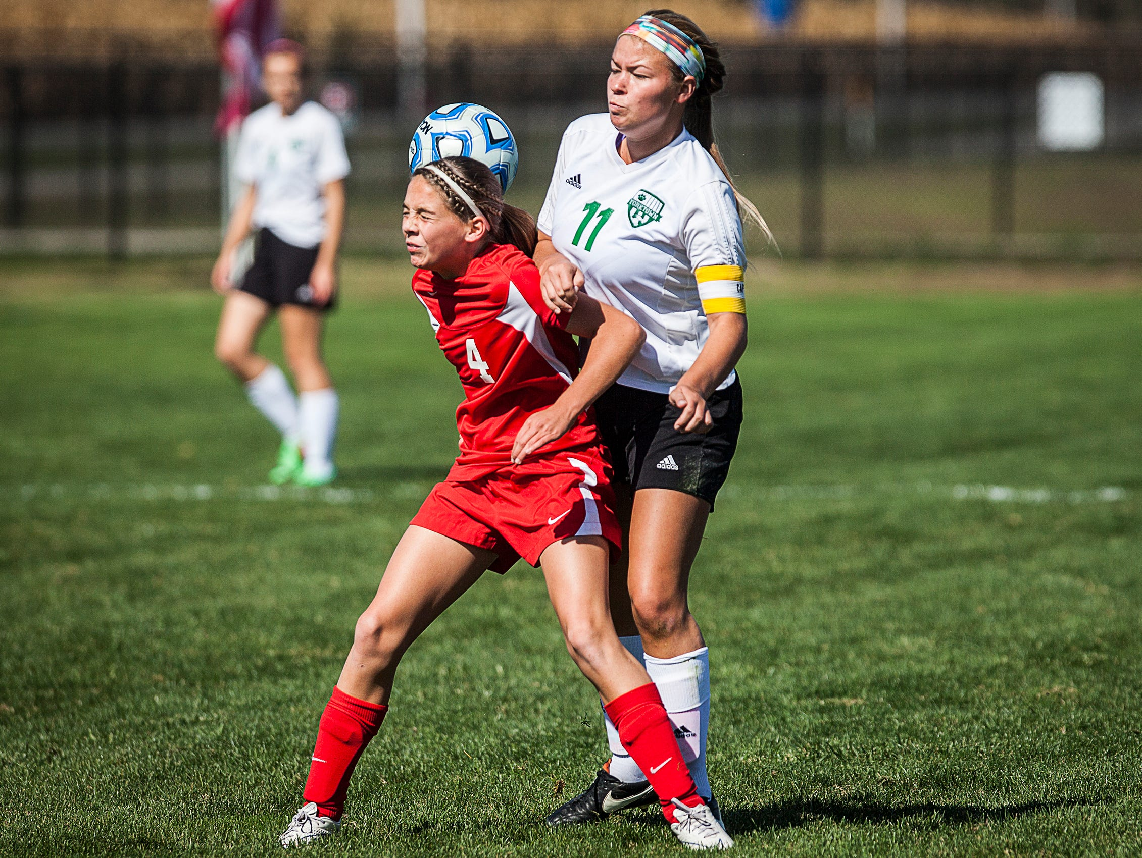 Yorktown's Katie Nixon and Jay County's Kendra Muhlenkamp struggle for possession during their game at the Yorktown Sports Park on Saturday, Oct. 10, 2015.