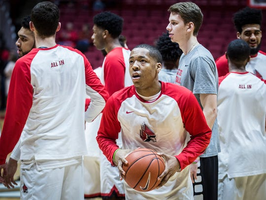 Ball State's Josh Thompson warms up with teammates